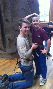 Levi Helping Ben With the Climbing Wall