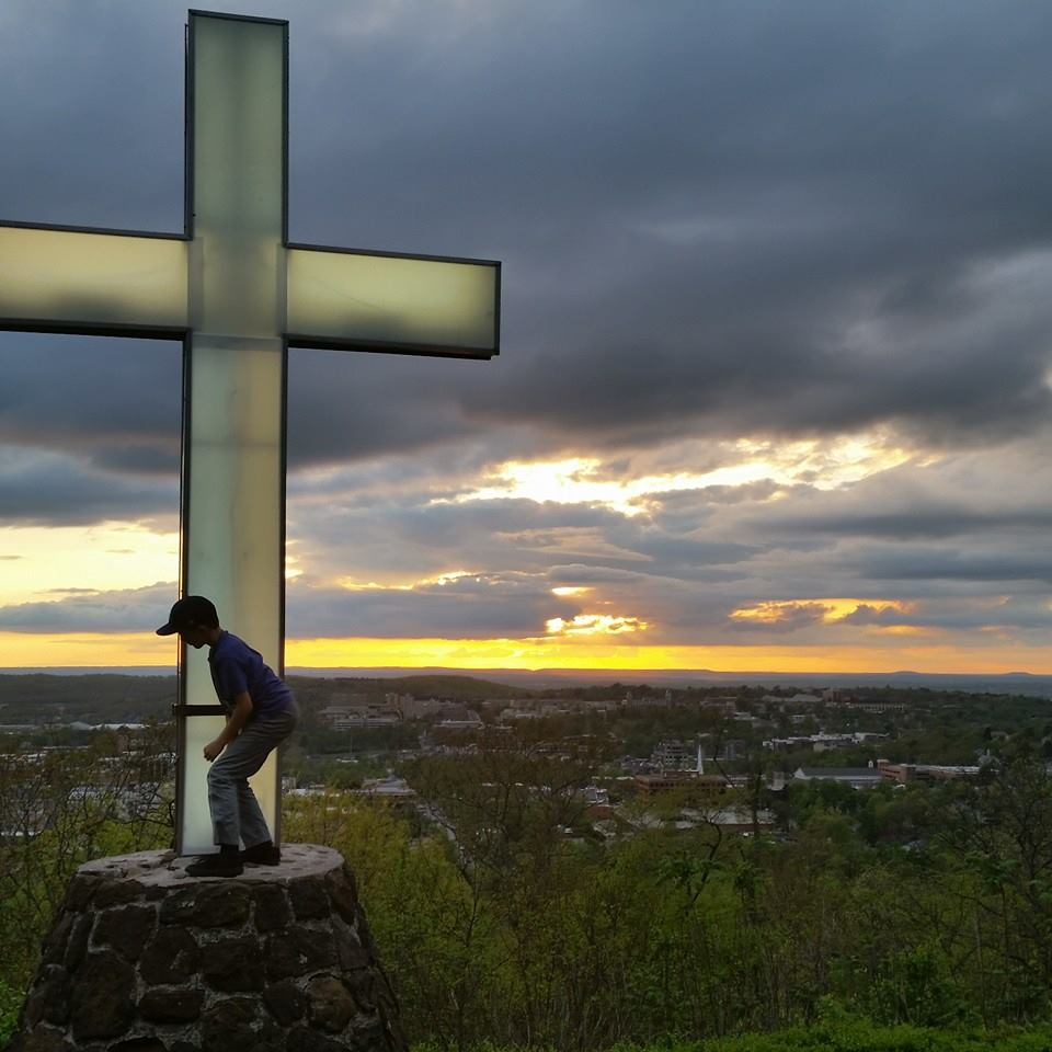 Ben Climbs Cross in the Skyline